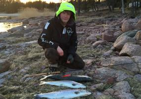 Filip with todays catch of fish on the cliffs